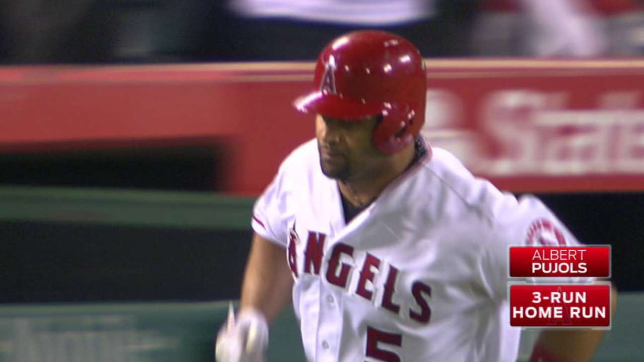Pujols' second three-run homer