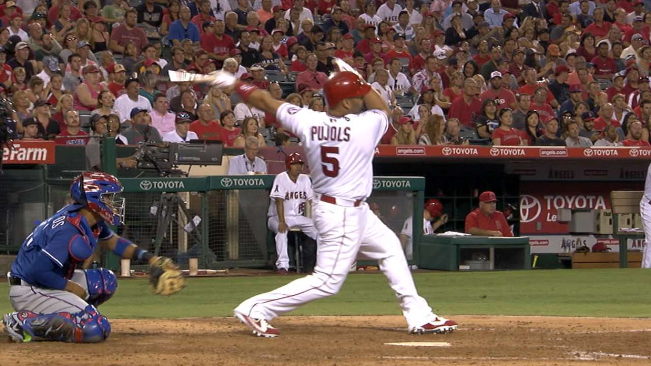 Pujols' two homers power Halos past Texas