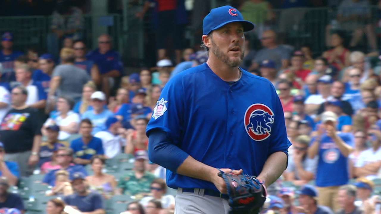 Nathan registers win, K's side in Cubs debut