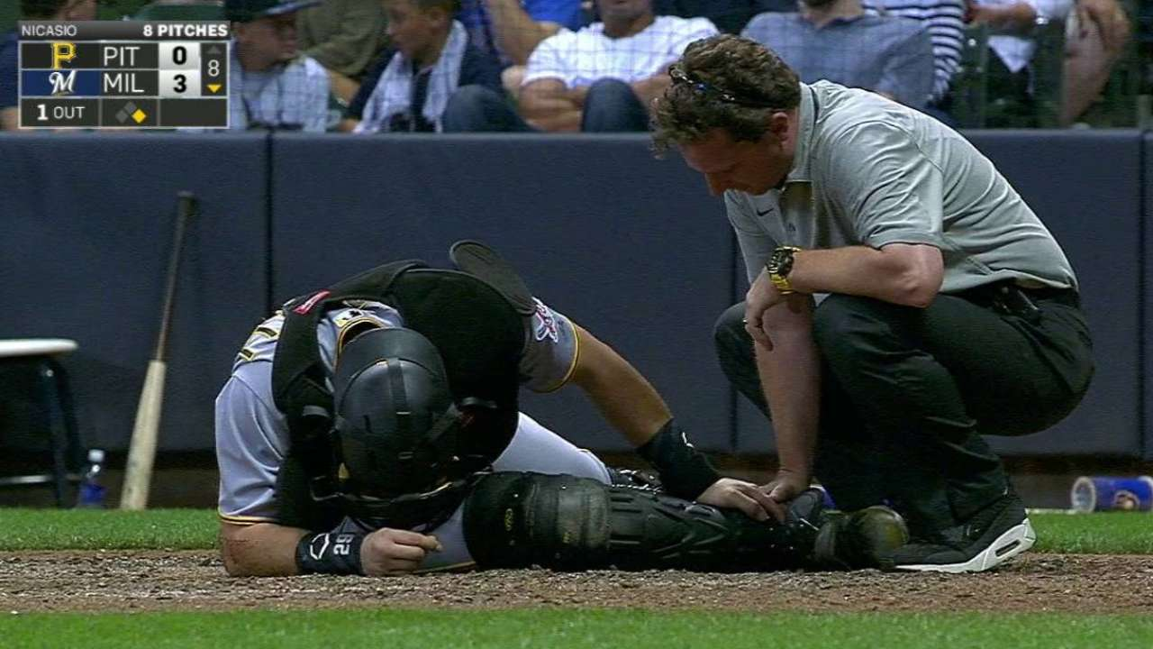 Cervelli exits vs. Brewers with right foot injury