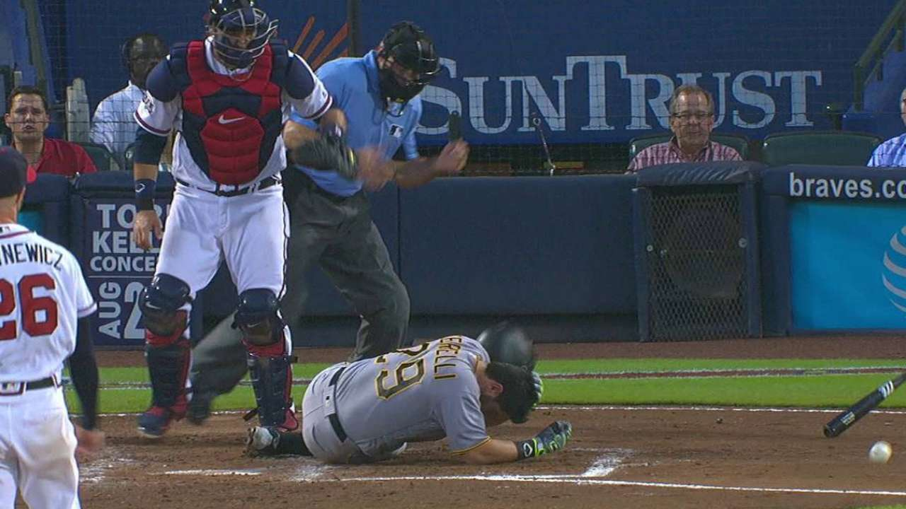 Cervelli exits after being hit by pitch on helmet
