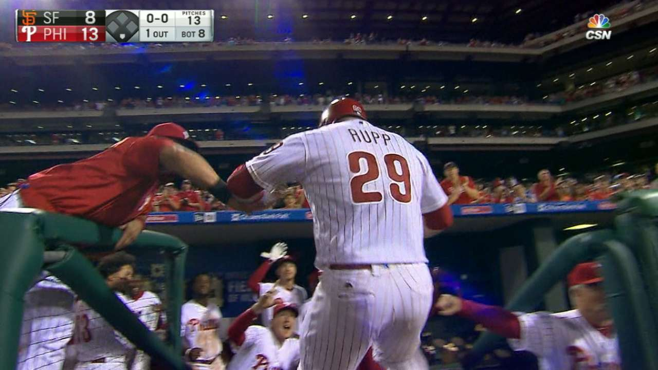 Phillies score five to take lead