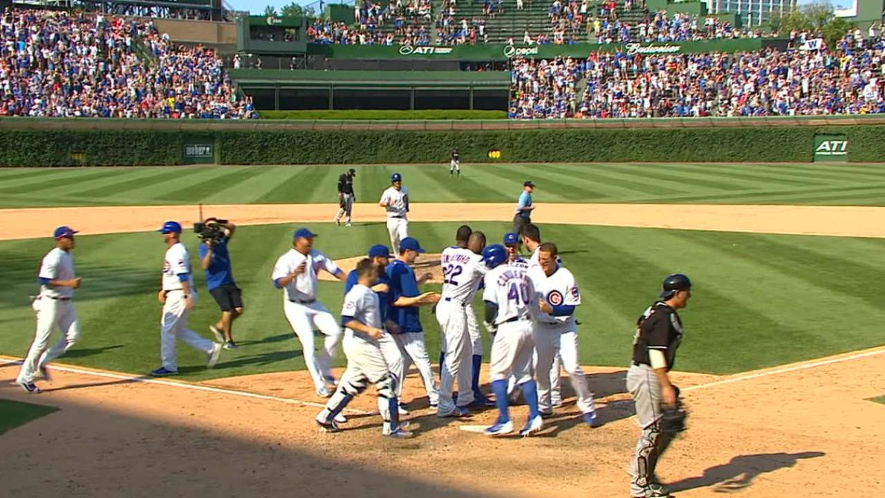 Cubs rally in 9th, stun Fish on walk-off wild pitch