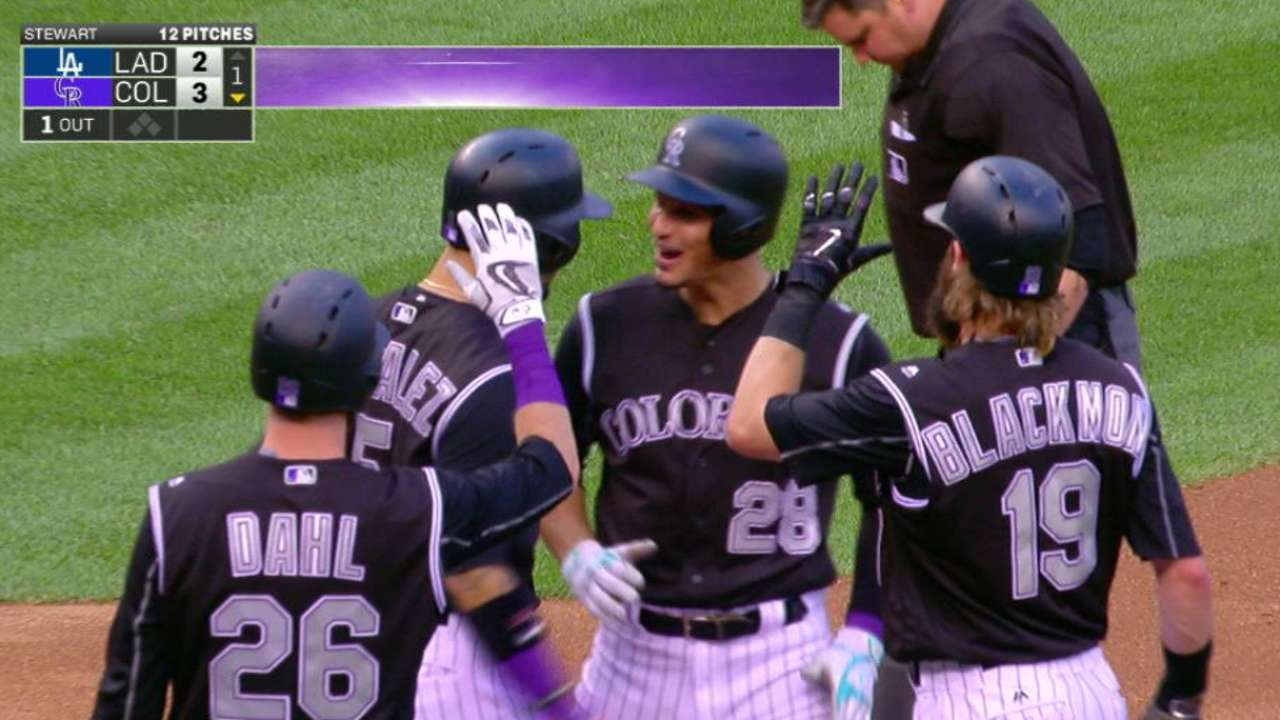 Arenado ignites Rox by ending homer drought