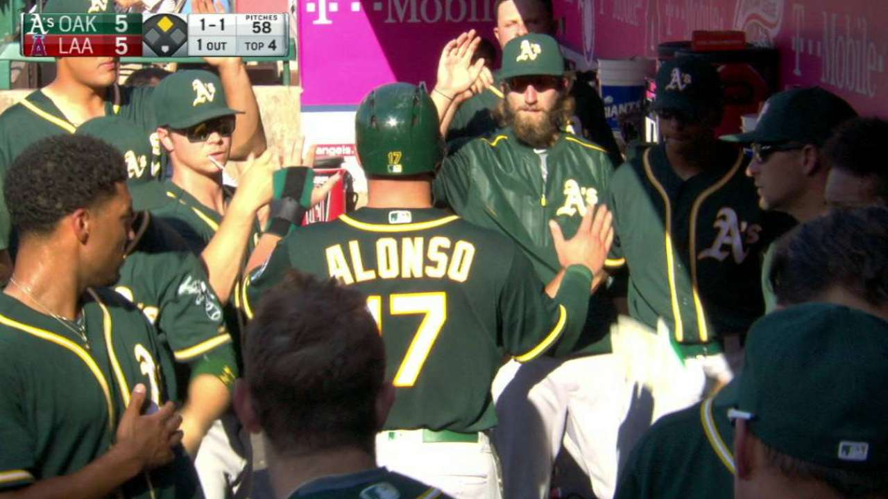 Alonso scores on wild pitch
