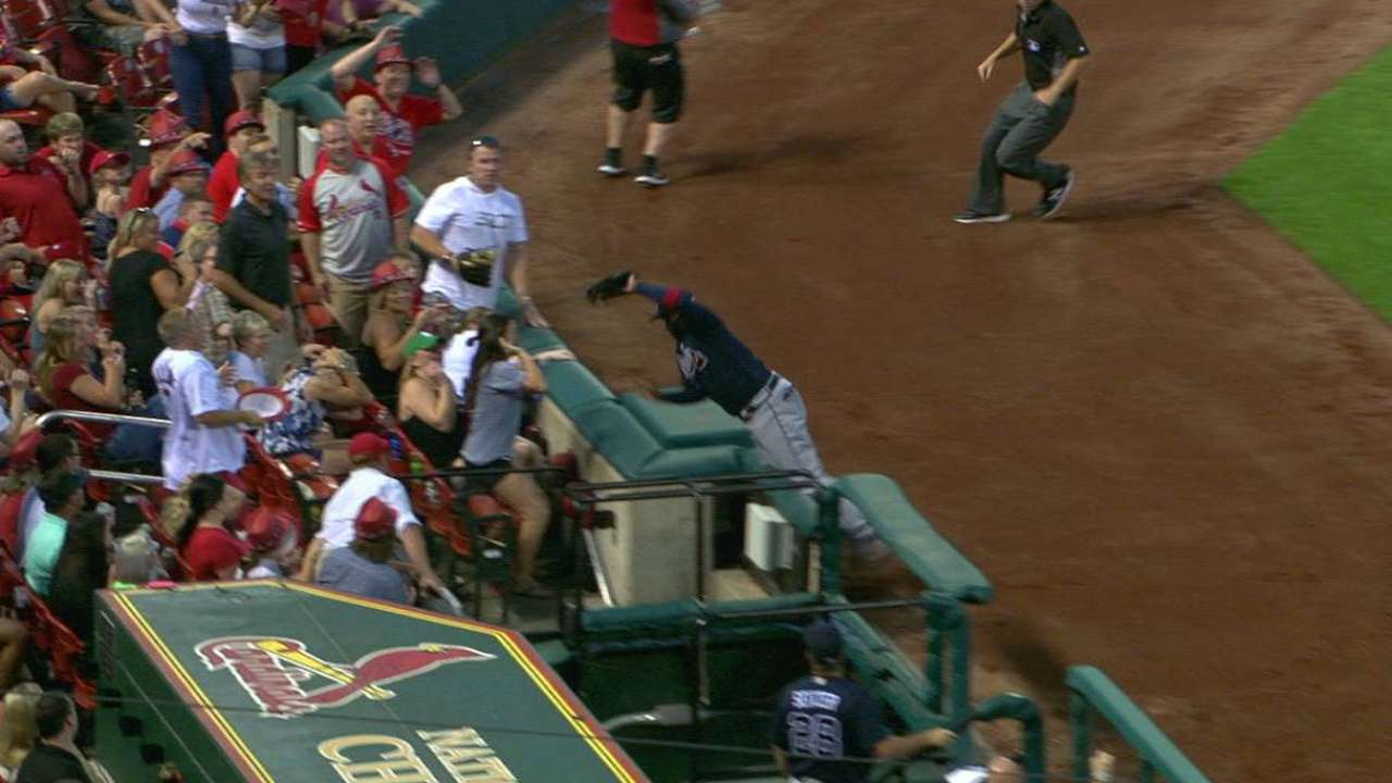 Garcia flips over railing to catch foul popup