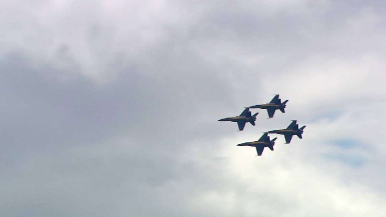Fighter jets fly over the park