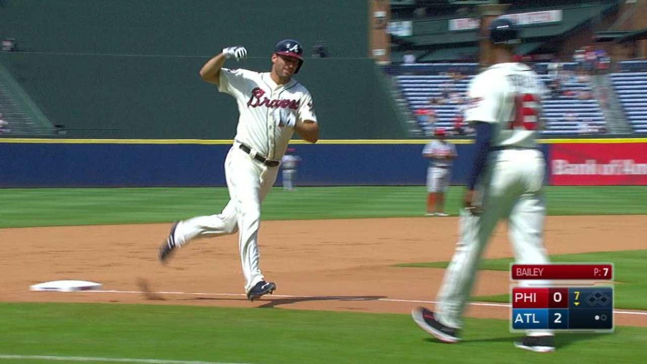 Bats break out after rain delay in Braves' win