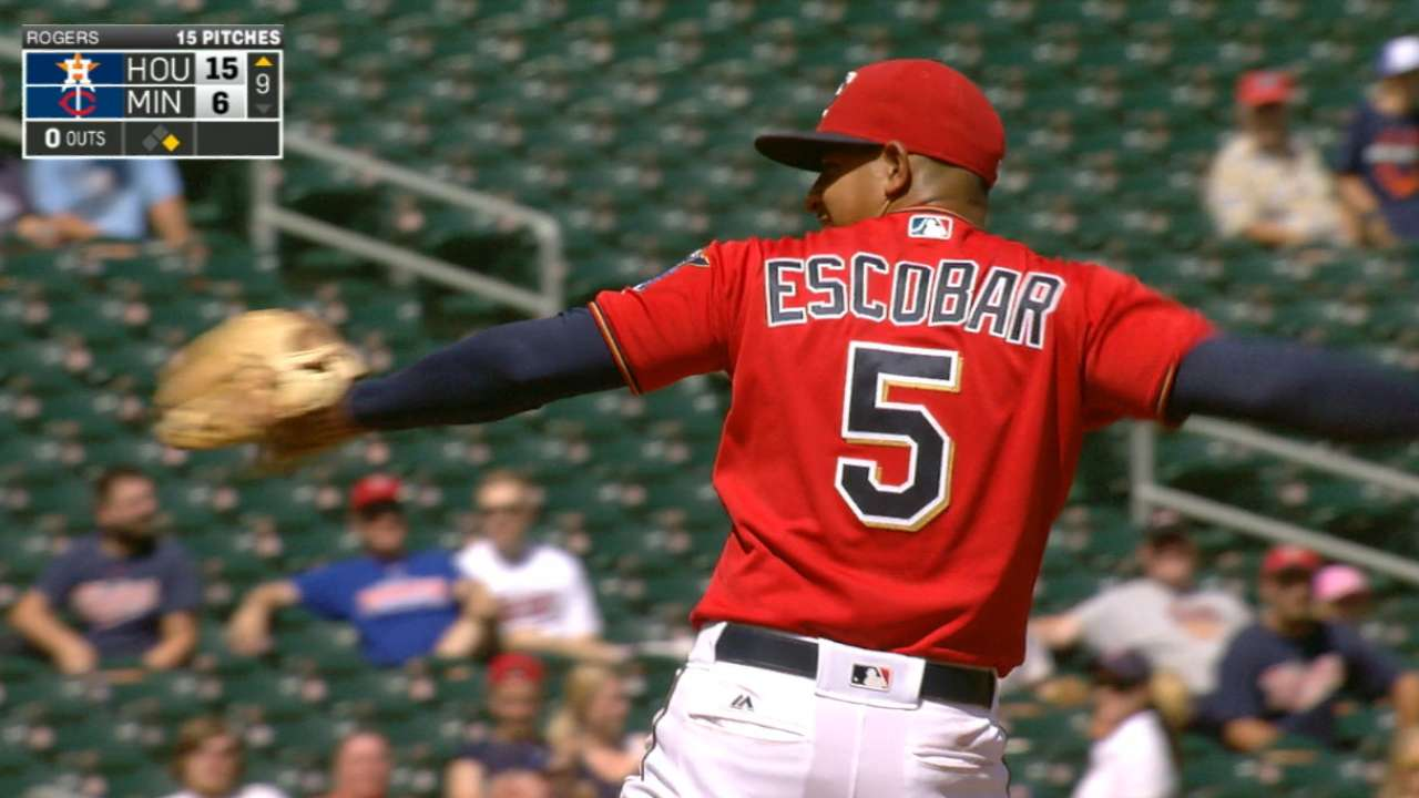 Infielder Escobar pitches in 9th