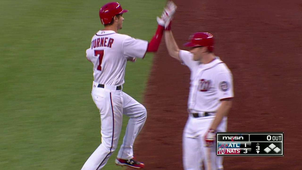 Nats hold off Braves for Lopez's 1st MLB win