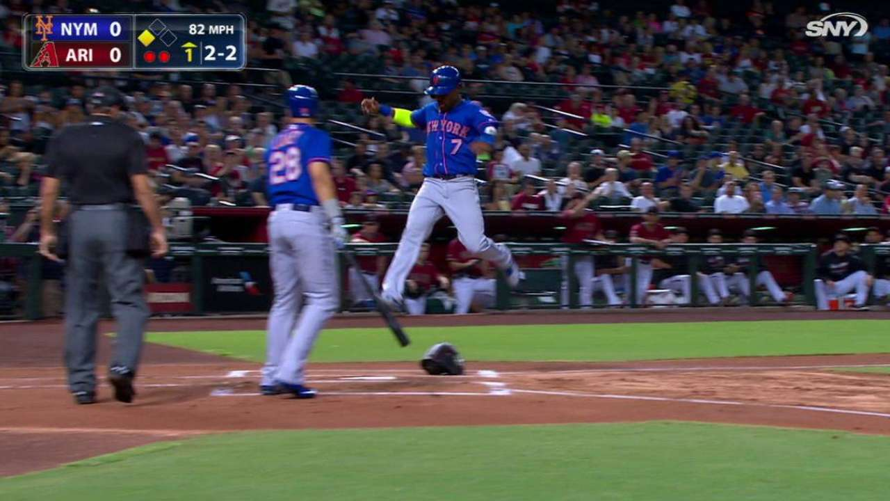Reyes scores on wild pitch