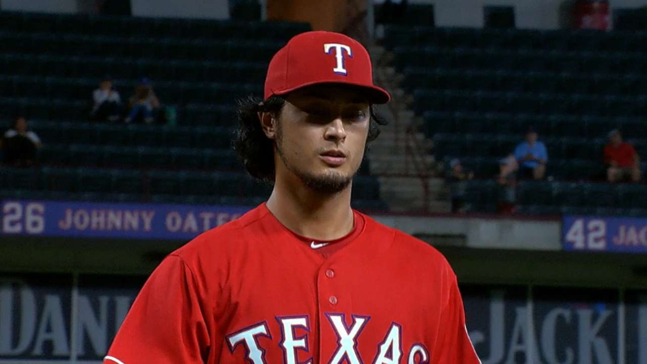 Darvish strikes out nine A's