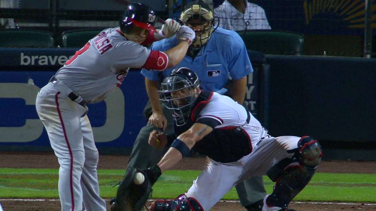 Espinosa dodges ball in dirt