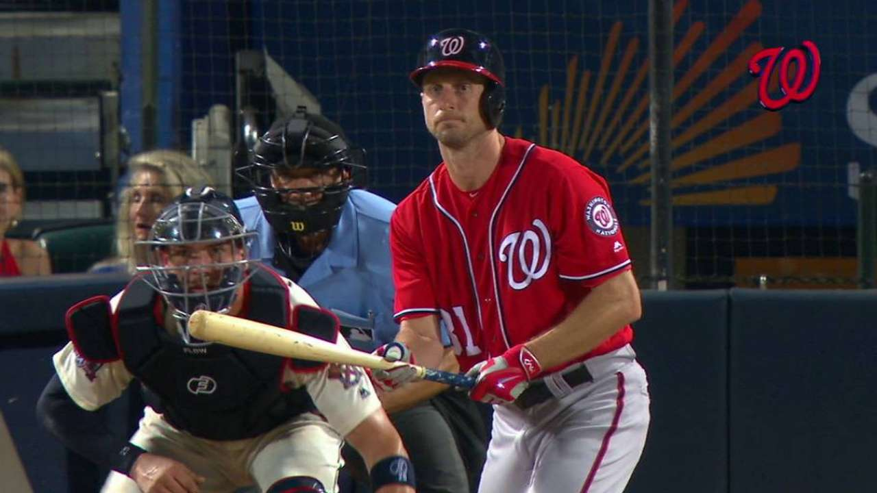 Scherzer collects 2 hits, settles down in win over Braves