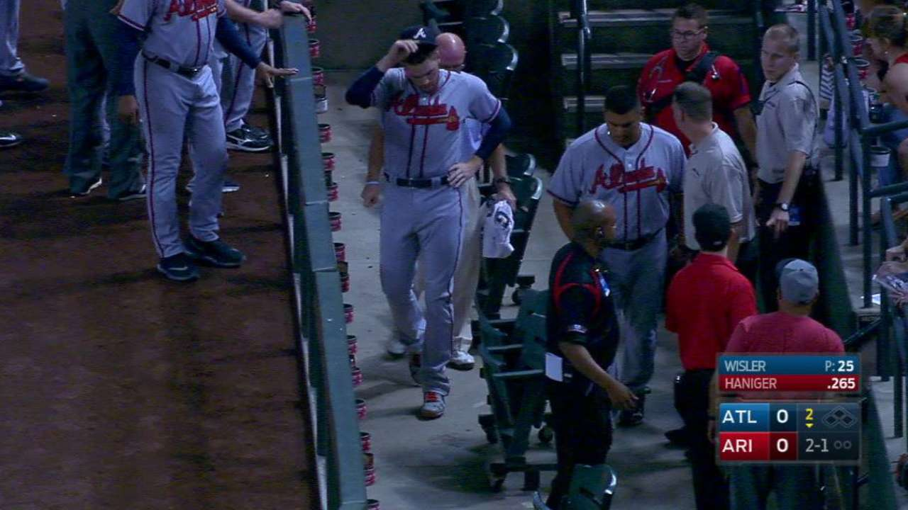 Freeman takes scary tumble, stays in game