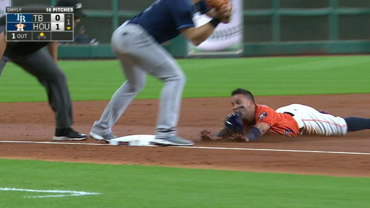 Altuve hustles after an error