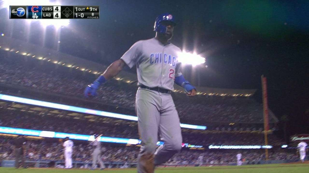 Heyward scores game-tying run