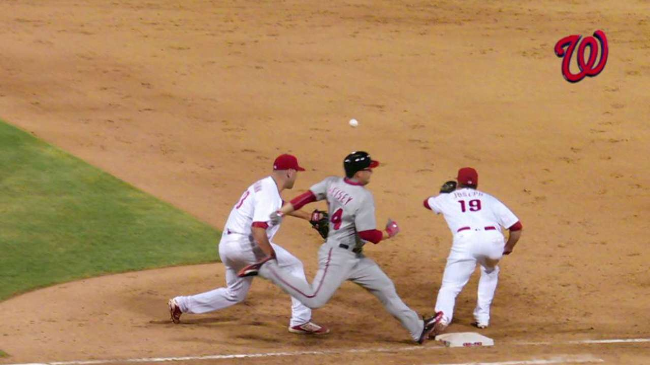 Phils challenge slide at second