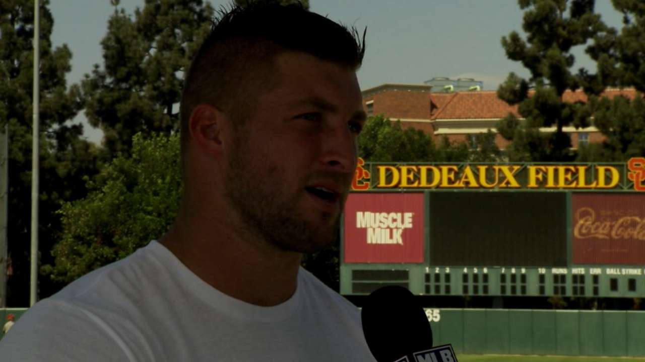 Tebow talks workout with Morosi