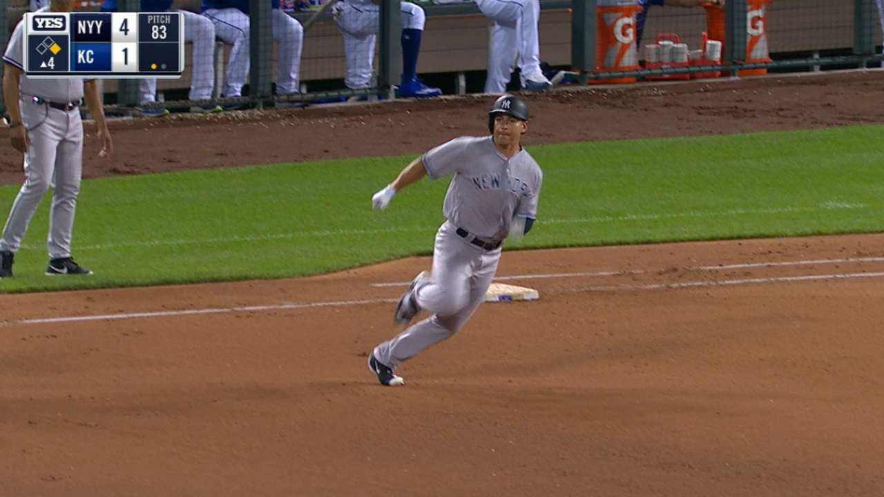 Yanks clip Royals in 10th to keep WC pace