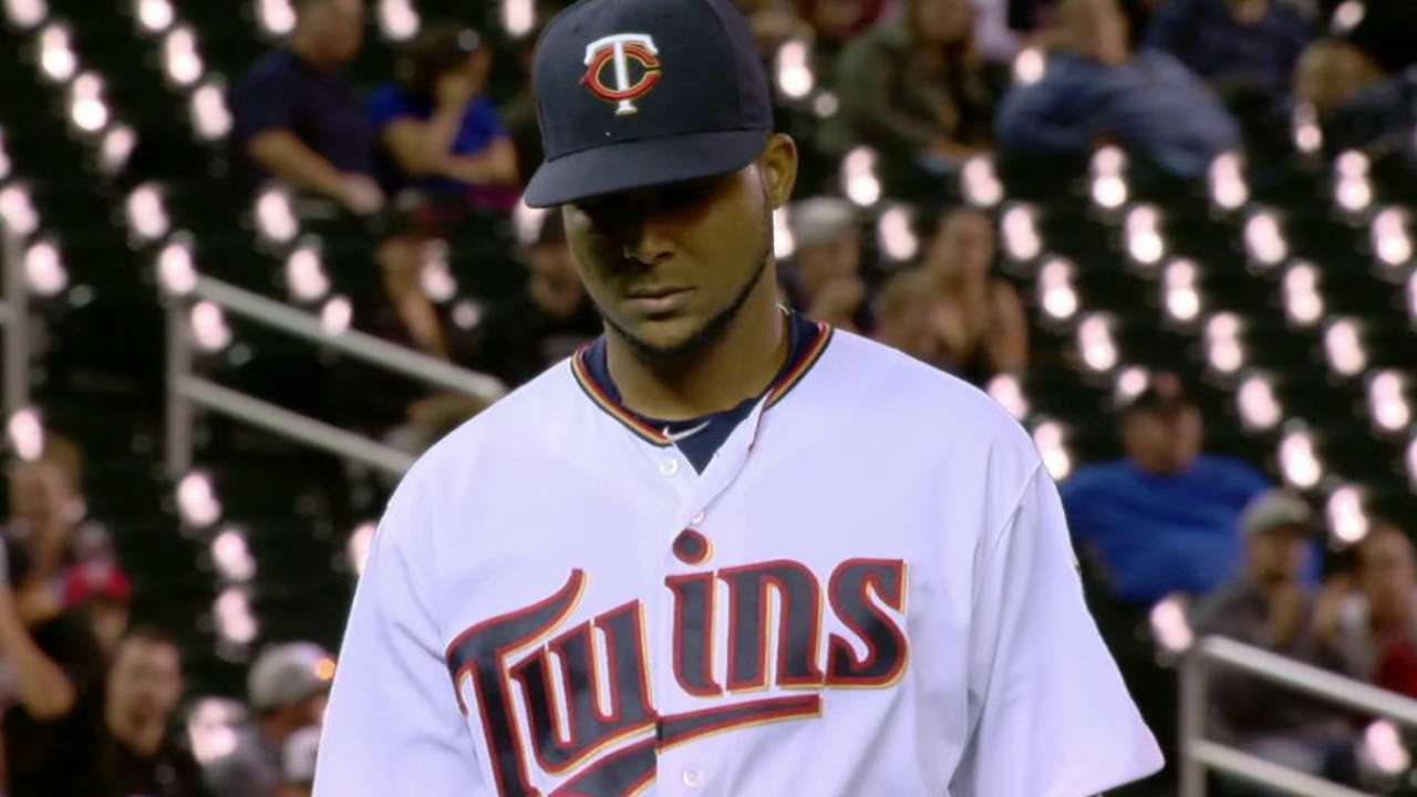 Santana wiggles out of jams, keeps Twins in game