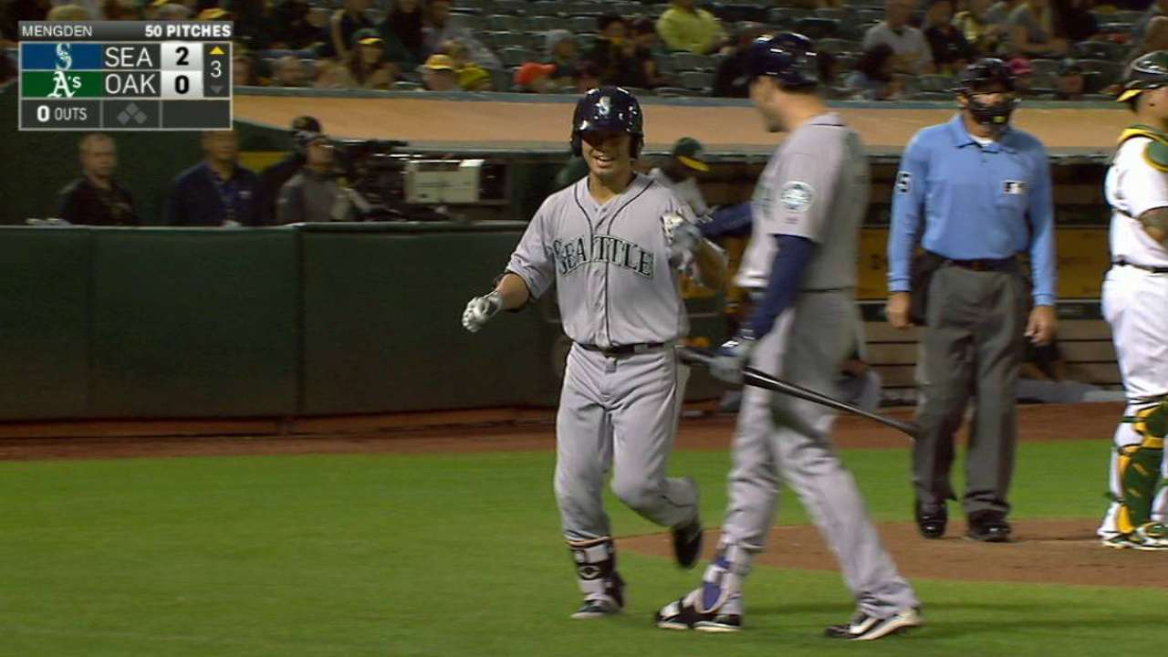 Mariners mash past A's, gain in WC chase