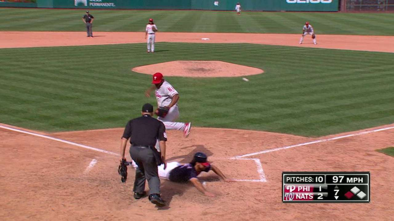 Rendon scores on a passed ball