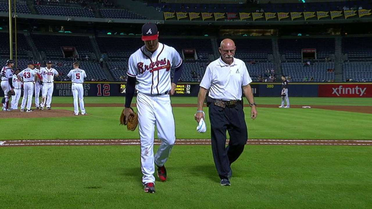 Foltynewicz exits with left calf contusion after comebacker