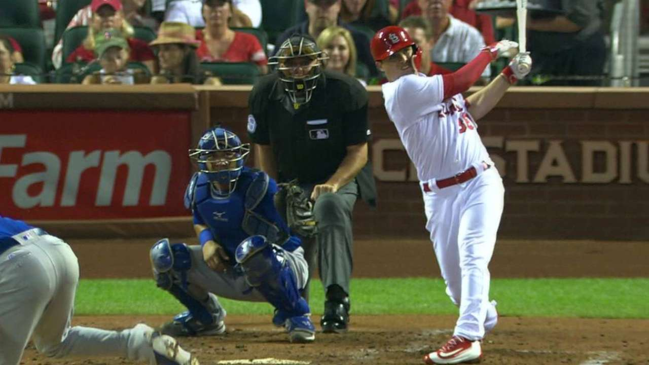 Cards rally vs. Cubs, stay right on Mets' heels