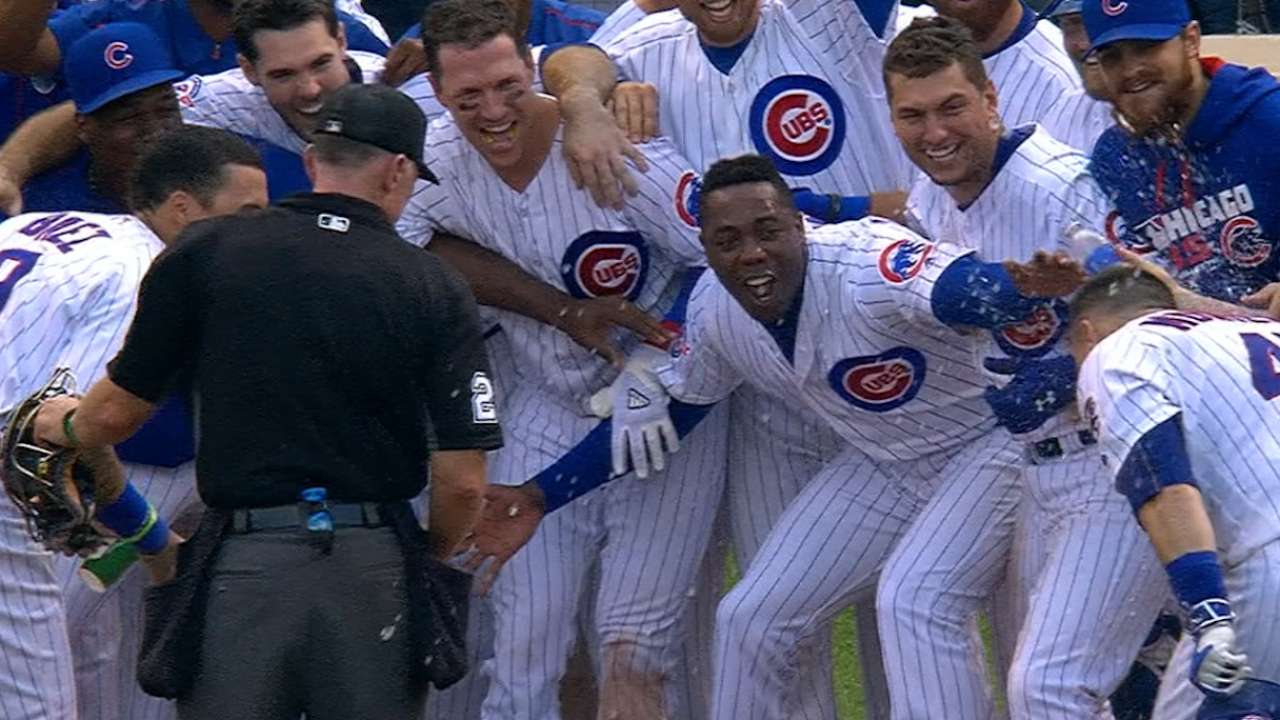 Already crowned, Cubs begin party with walk-off