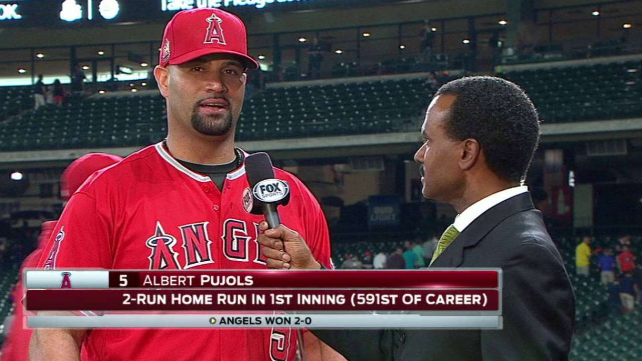 Pujols on homer, win