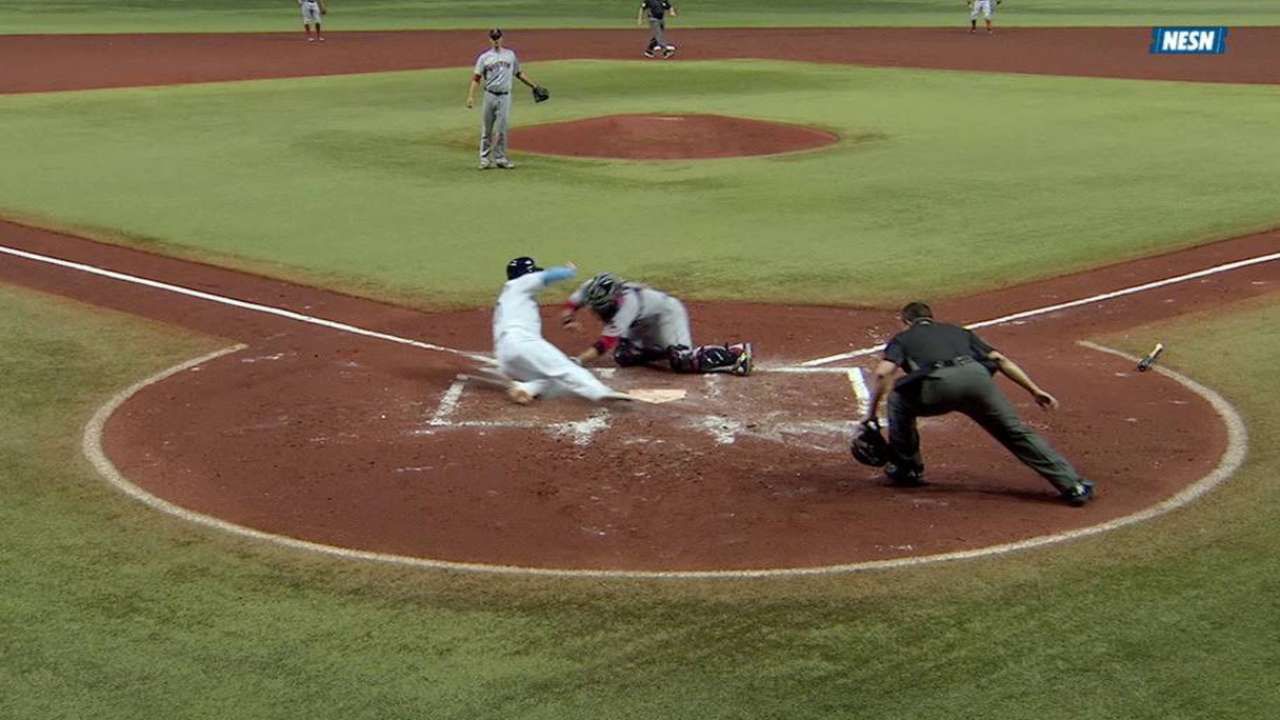 Pedroia stops a run from scoring