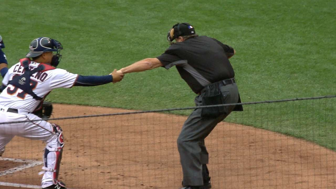 Umpire Layne leaves game with concussion-like symptoms
