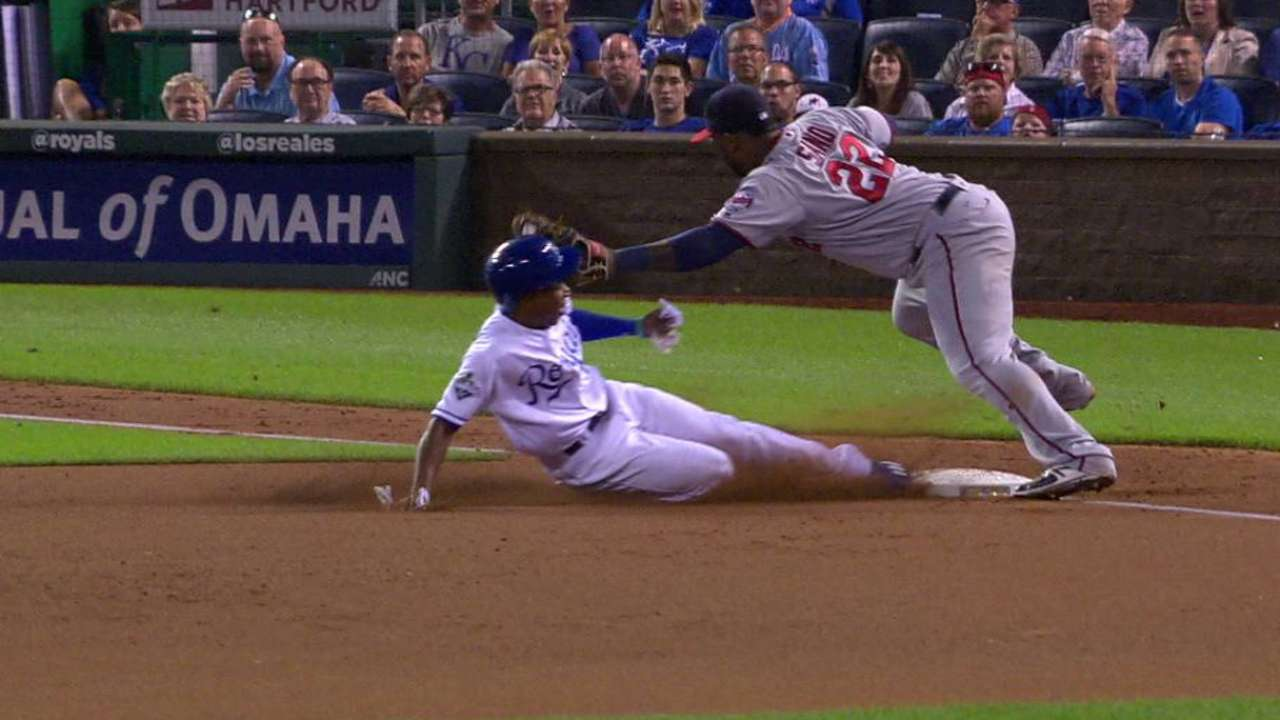 Gore steals third after review