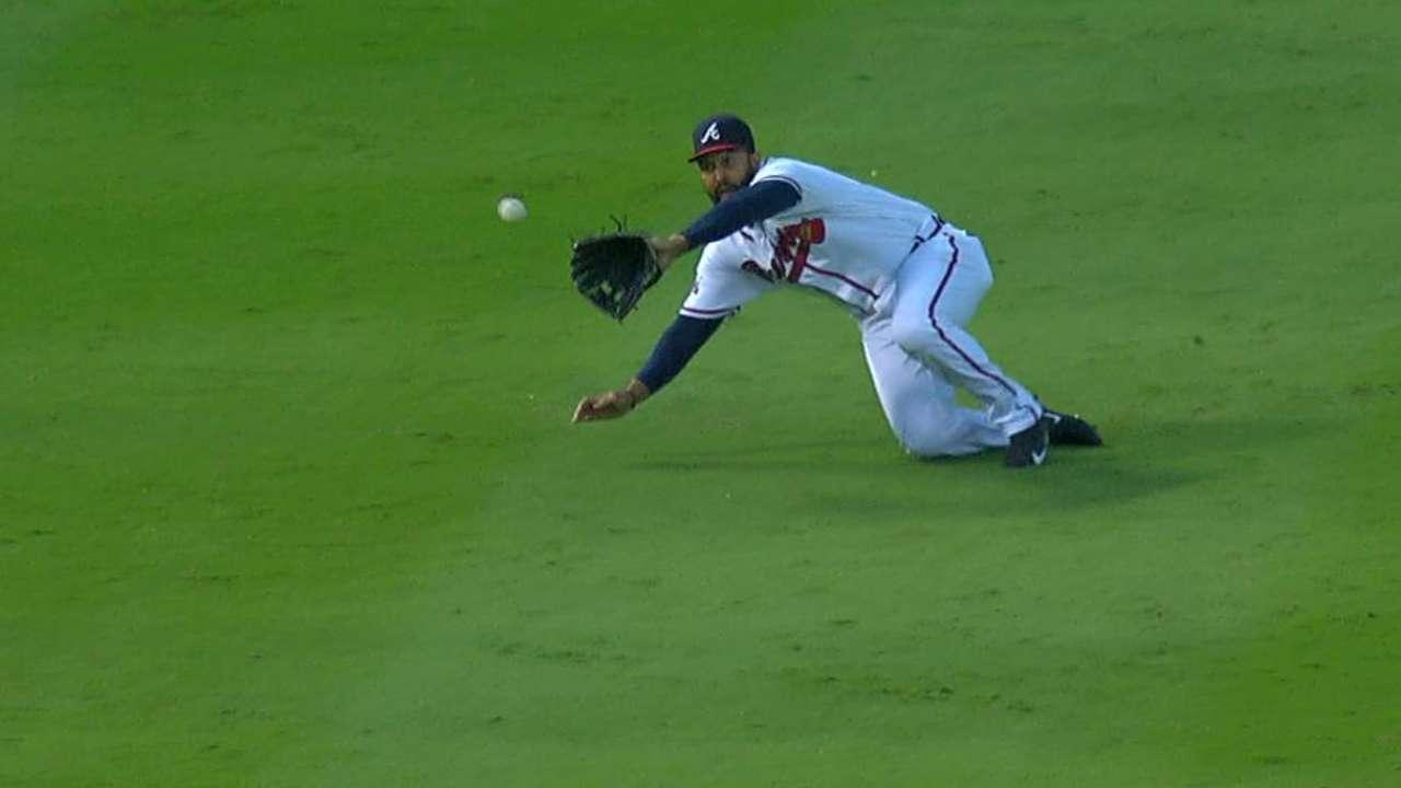 Kemp makes a sliding grab