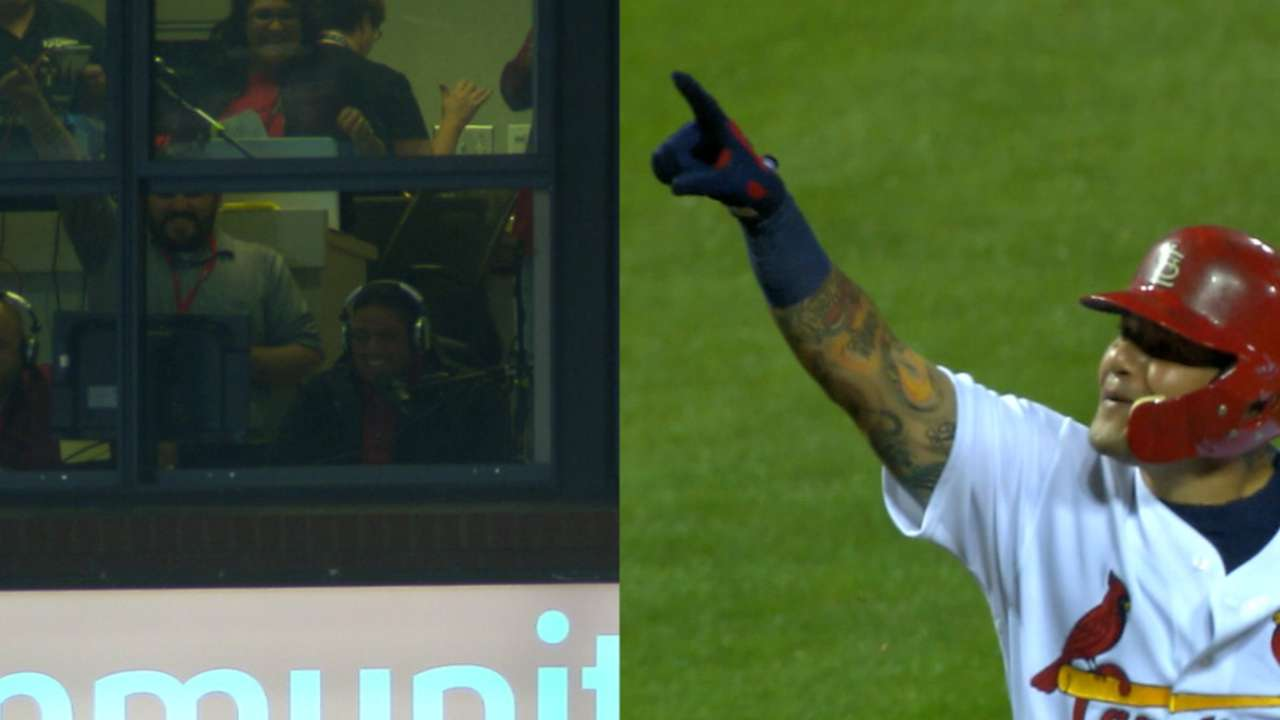 Molina hits homer, points to bro