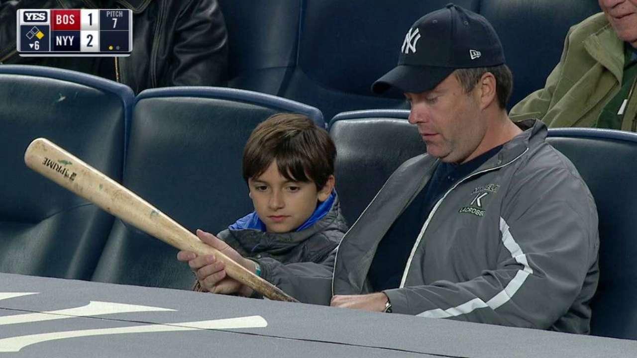Fan gets a bat from Gregorius