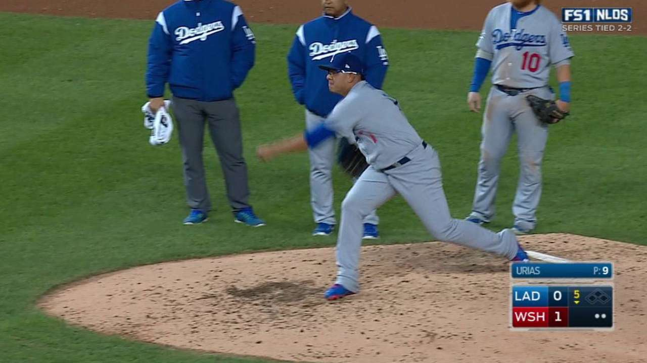 Urias checked on, stays in game