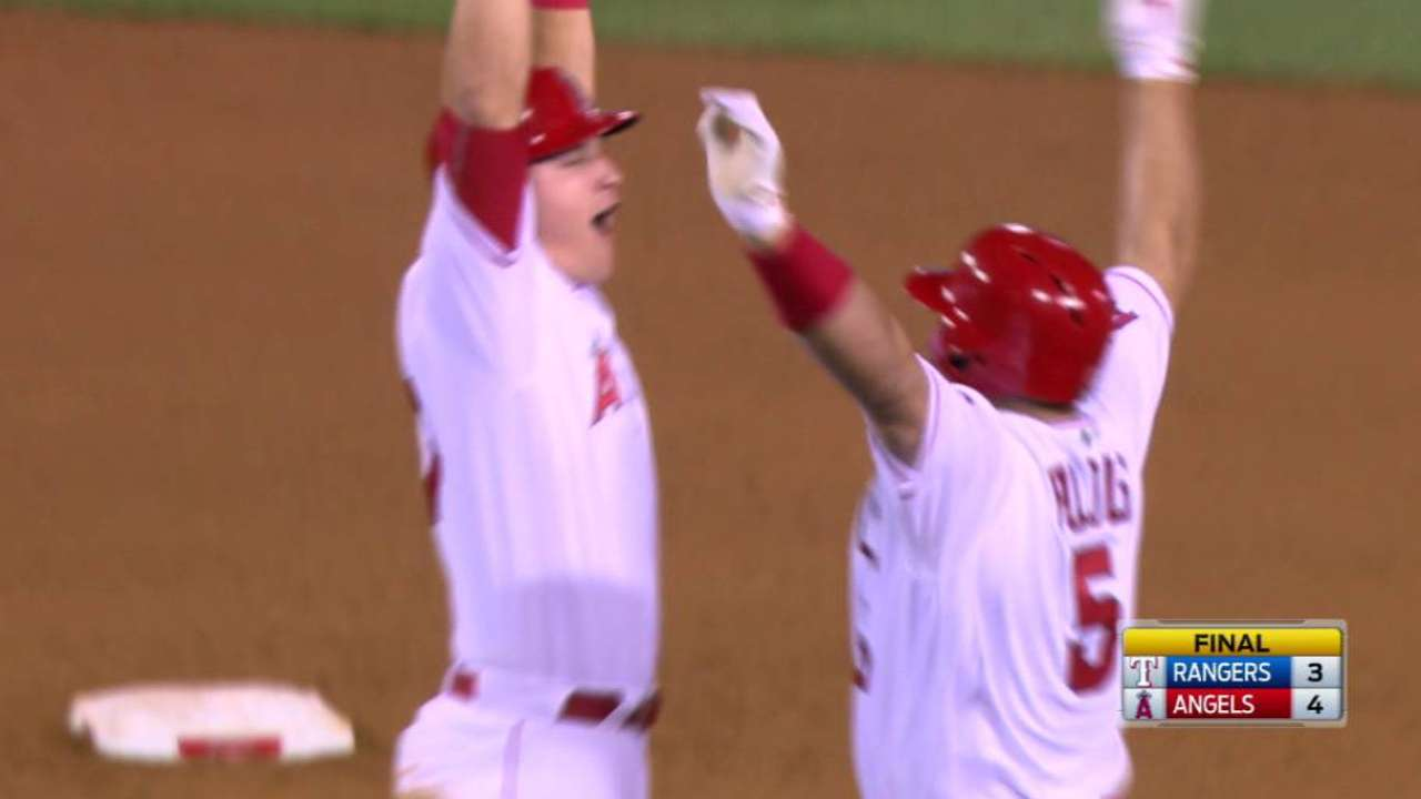 After Rangers walk Trout, Pujols makes them pay