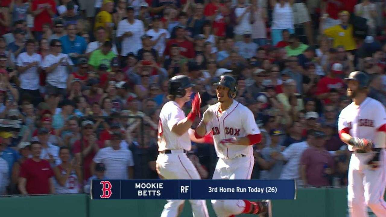 Betts, Boston's batting barrage bring brooms