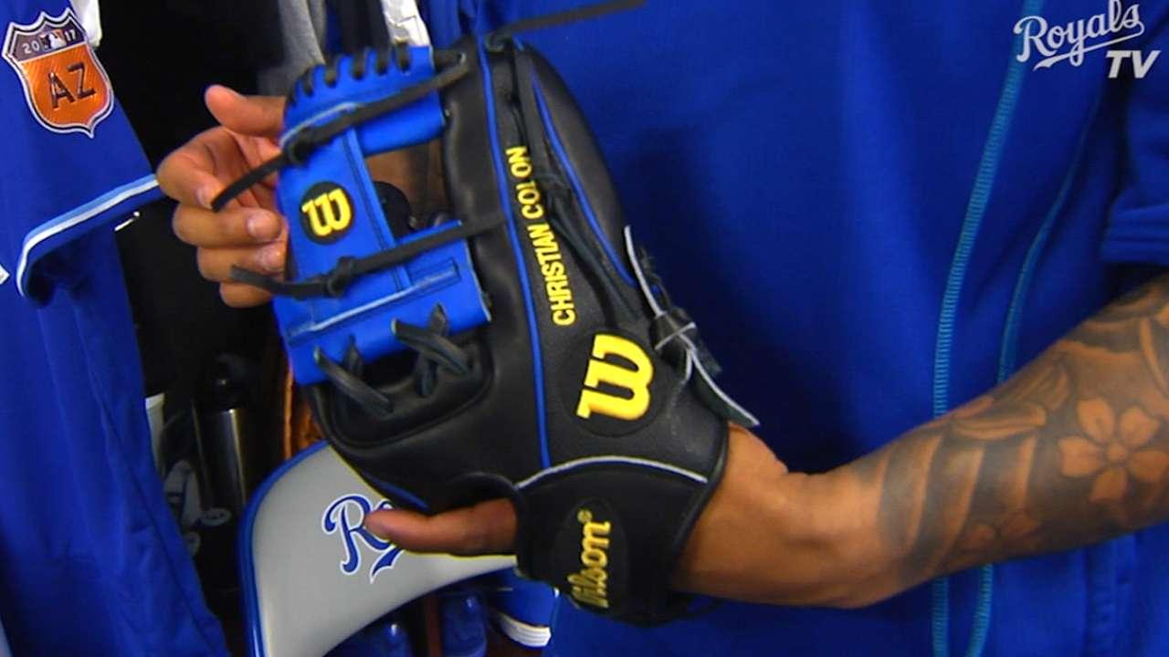 Colon shows off new glove
