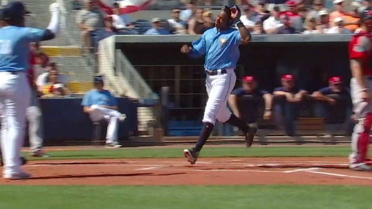 Sucre comes through with bat, behind plate