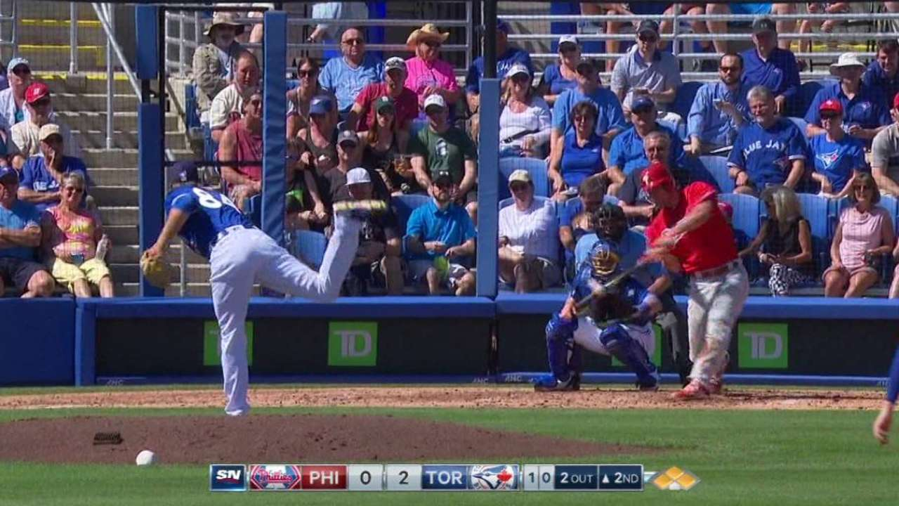 Phils capitalize on Jays' errors, roll to win