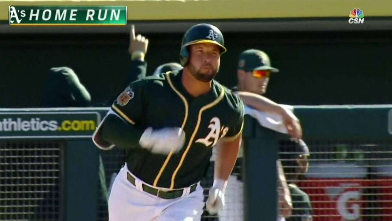 Alonso's homer leads A's late rally