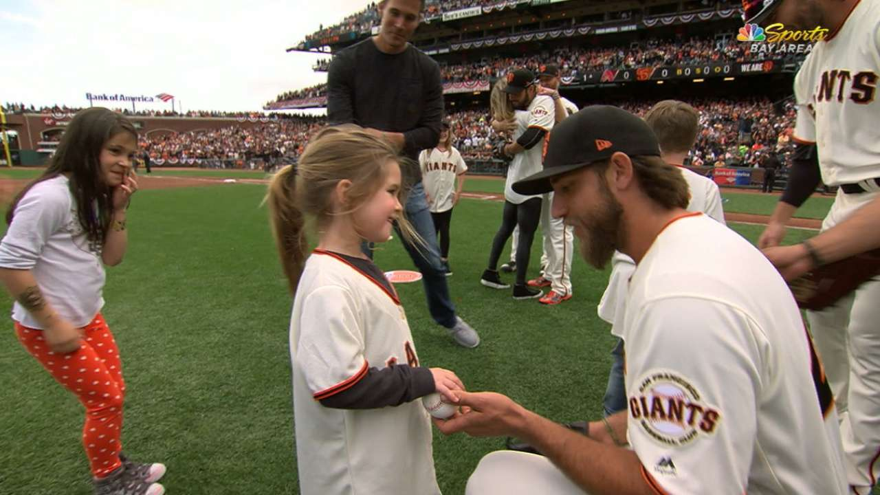 Owens family throws first pitch