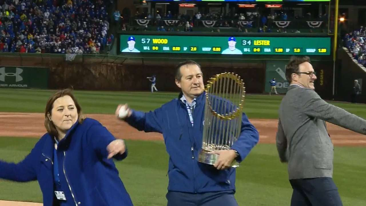 Cubs owners throw first pitch