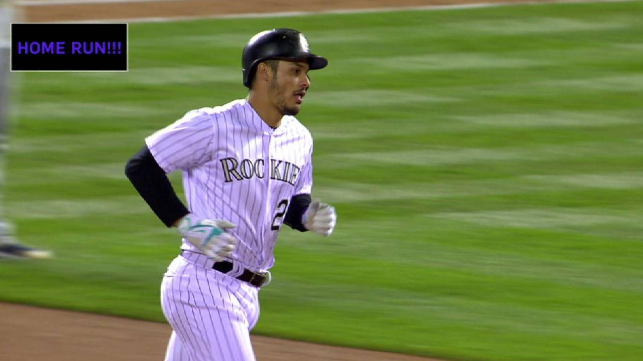 Trio of solo shots lifts Rockies over Padres