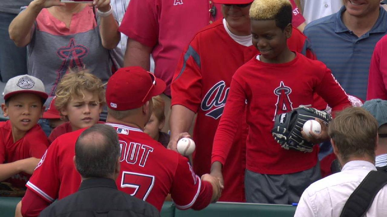 Trout plays catch with a fan