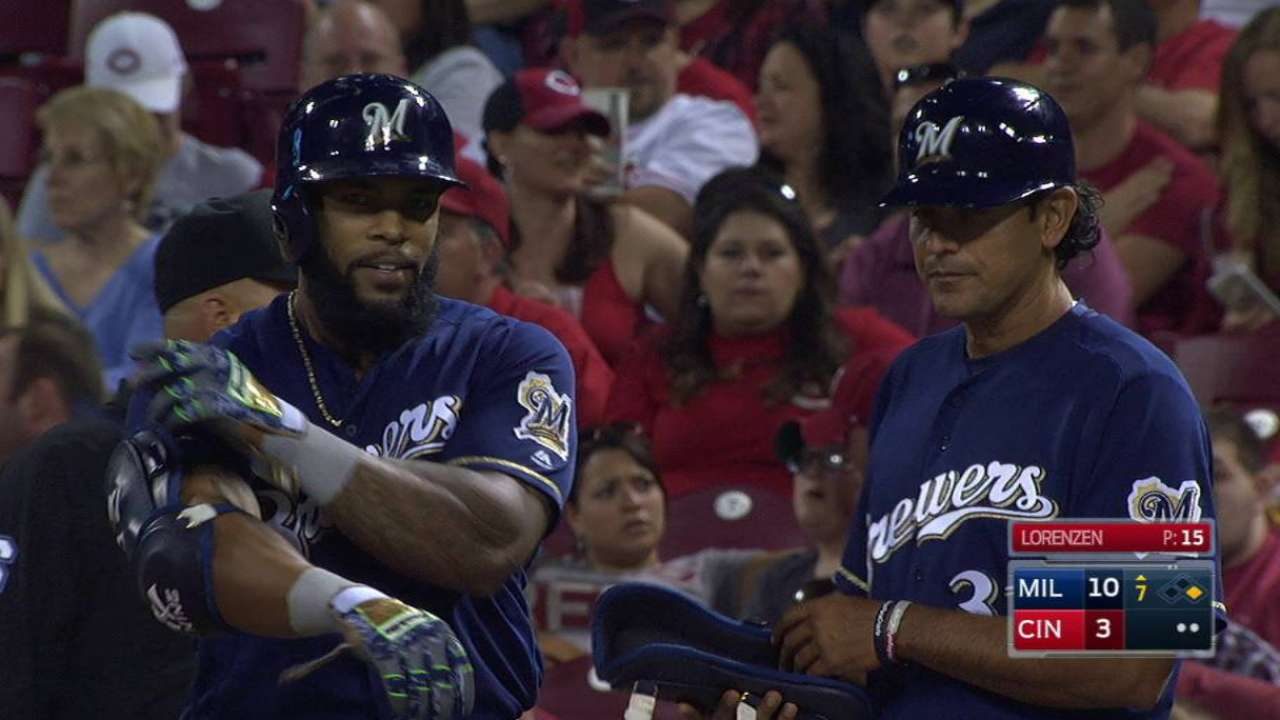 Crew erupts for 8 runs off 'pen to top Reds