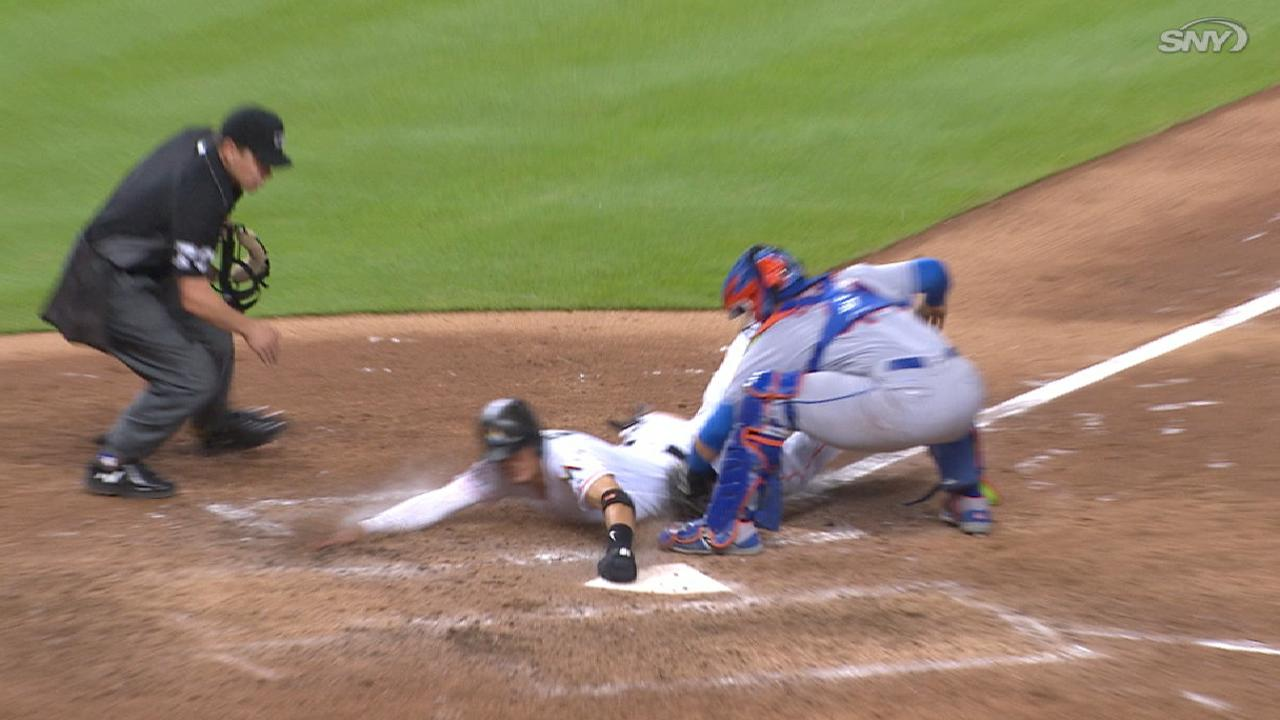 Conforto preserves late tie with throw to plate